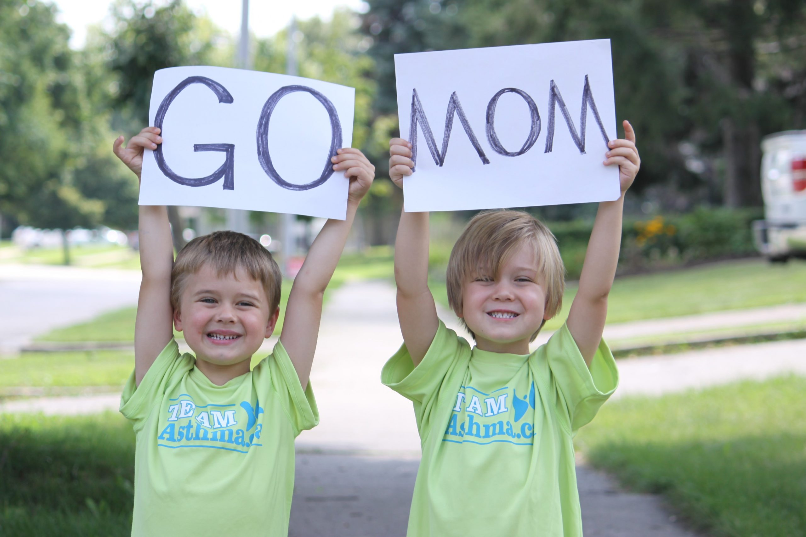 Two boys holding up a Go Mom Sign and wearing Team Asthma T-shirts - Host your own fundraiser image